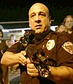 Lt Ray Albers points rifle in Ferguson.jpg