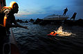 MPOTY 2014 Petty Officer 3rd Class pulls 10-year-old toward a Coast Guard boat while rescuing him.jpg