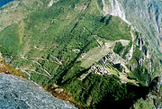 View of Machu Picchu from Huayna Picchu, showing the Hiram Bingham Highway used by buses carrying tourists to and from the town of Aguas Calientes.