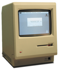 A w:Macintosh 128K (that has apparently been u...