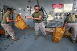 Mail call, U.S. Marines and Sailors sort packages 150815-M-TJ275-026.jpg
