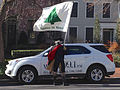 Man in Colonial American costume with Appeal to Heaven flag and radio news car, Capitol Hill.jpg