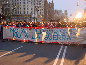 "Reactions to the 2004 Madrid train bombings - Demonstration in Barcelona. The banner, in Catalan, reads ""No to terrorism, no to war"""