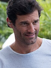 Portrait of Mark Webber smiling and looking to the left of the camera