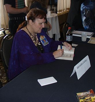 Mercedes Lackey - Lackey signing autographs at CONvergence