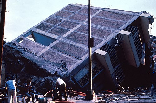 Eight-story frame structure with brick infill walls broken in two. The foundation also came off. MexCity85quake.jpg