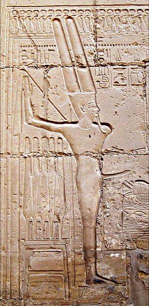 Min (god) - Belemnite shown on left of Min