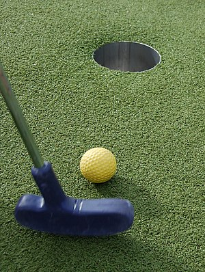 Miniature golf-club and ball.