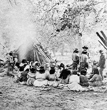 1872 photograph of Southern Miwok council in Yosemite Valley Miwok on Merced River.jpg