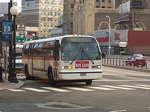 Journal Square Transportation Center - Bus at Journal Square before turning into Pavonia Avenue and  entrance to bus platforms, followed by a guagua (minibus), which also serves the region
