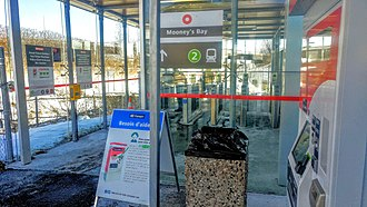 Mooney's Bay station - Renovated station entrance with fare gates, Presto card and ticket machines, and bilingual signage. December 2018