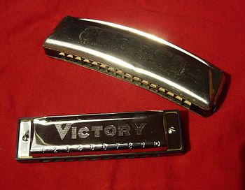 diatonic harmonicas :a) upper: blues harp (C) ...