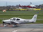 N67DP Cirrus SR22 With G-PWIT Bell Jet Longranger 206 Helicopter (26417774922).jpg