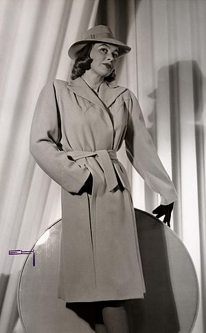 Swedish fashion - A Swedish fashion image from 1943. The long trench coat and hat provide protection from the outside climate, while still offering an aesthetic quality.