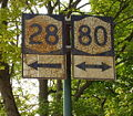 NY 28-NY 80 old shields in Cooperstown.jpg