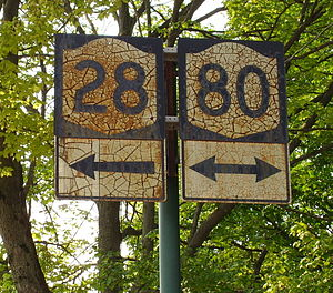 New York State Route 80 - Old shields in Cooperstown for NY 28 and NY 80