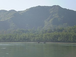 Arakan Mountains - View of the Arakan Mountains in Maungdaw district rising above the banks of the Naf River