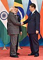 Narendra Modi being received by the President of the People's Republic of China, Mr. Xi Jinping, at the Dialogue of Emerging Markets and Developing Countries, during the 9th BRICS Summit, in Xiamen, China.jpg