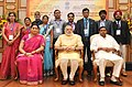 Narendra Modi in a group photograph at an informal interaction with the National Awardee Teachers, on eve of the Teachers' Day, in New Delhi. The Union Minister for Human Resource Development (3).jpg
