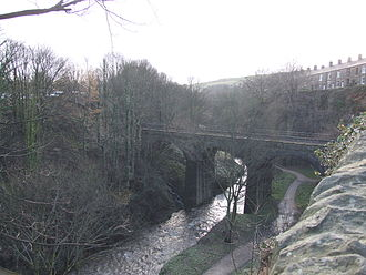 New Mills - The Torrs is a gorge through Woodhead Hill Sandstone in New Mills. The River Sett approaches its confluence with the River Goyt. Spanning the Sett is the 1864 viaduct on the Hope Valley Line, which has emerged from a tunnel on the right, under Union Road.