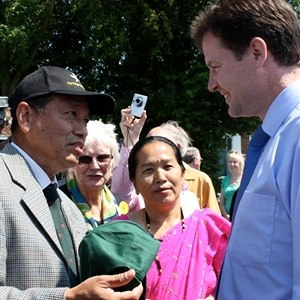 Gurkha Justice Campaign - Nick Clegg being presented a Gurkha Hat, by a Gurkha veteran during his visit to Maidstone, to celebrate the success of their joint campaign for the right to live in Britain, 2009.