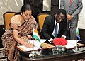 Nirmala Sitharaman and the Minister for Industry, Trade and Investment, Tanzania, Mr. Charles John Mwijage signing the mutually agreed document, at the Fourth Session of the India-Tanzania Joint Trade Committee meeting.jpg