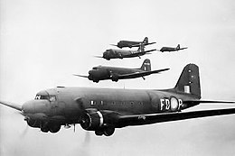 Five twin-engined cargo planes in flight