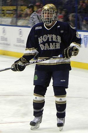 Notre Dame Fighting Irish men's ice hockey - Notre Dame hockey player in an away uniform (2010).