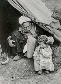 Nakba 1948 oldman and baby tent
