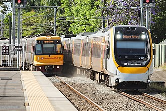 Queensland Rail - Queensland Rail's oldest and newest electric rolling stock. An EMU and an NGR at Altandi station.