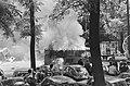 Onlusten in Amsterdam, brandende Telegraaf autos op Noordzijdevoorburgwal, Bestanddeelnr 919-2497.jpg