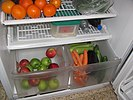 Open crisper drawers