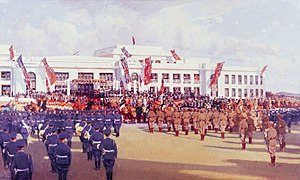 Australian Red Ensign - The opening of Federal Parliament at Canberra, 9 May 1927. Note the Red Ensigns hanging alongside the Union Flags, showing that even during official government events the Red Ensign was still used to represent the people of Australia.