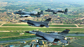 Osan Air Base - American 51st Fighter Wing's F-16C Fighting Falcons and A-10A Thunderbolt IIs flying over Osan Air Base in June 2009.