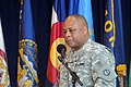 Outgoing commander gives farewell remarks during relinquishment of command ceremony 140607-A-KL464-035.jpg