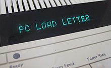 """PC LOAD LETTER"" in a printer console's LED display"