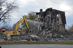 Dust abatement - Water being sprayed on a demolition site