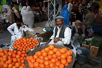 Saraiki culture - A fruit vendor in a fruit market in the heart of Multan