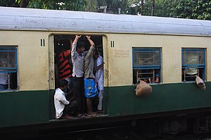Hridaypur railway station - Image: Passengers Kolkata Local Train