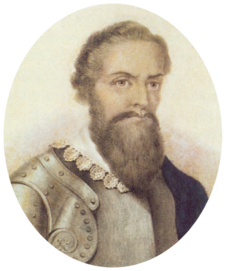 Half-length monochrome portrait of a bearded man with a lace collar over armor.