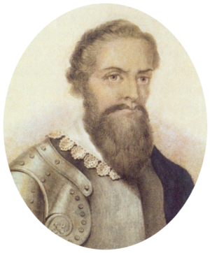 Half-length monochrome portrait of a bearded man with a lace collar over armor