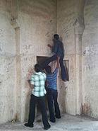People defacing the Golconda walls