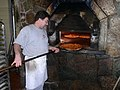 Pizza baking in brick oven, New Haven.jpg