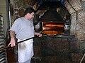Pizza baking in brick oven, New Haven.jpg