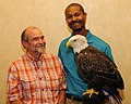 Posing for picture with Bald Eagle. (10594116694).jpg
