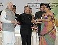 Pranab Mukherjee presenting the National Award for Teacher-2011 to Smt. Dalasaniya Ramaben Haribhai, Gujarat, on the occasion of the 'Teachers Day'.jpg
