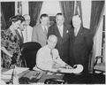 President Truman signing a bill in the oval office making the governorship of Puerto Rico an elected office. L to R... - NARA - 199699.tif