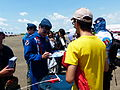 ROCAF Major Hunk Lou Signing on Booklet for Visitor 20130810.jpg