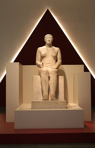 Vizier (Ancient Egypt) - Statue of Hemiunu, vizier and designer of Khufu's pyramid at the Roemer- und Pelizaeus-Museum Hildesheim, Germany. His feet rest on columns of hieroglyphs, painted in yellow, red, brown, and black.