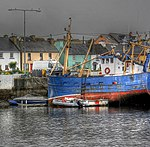 Red and blue boat by town (8045559981).jpg